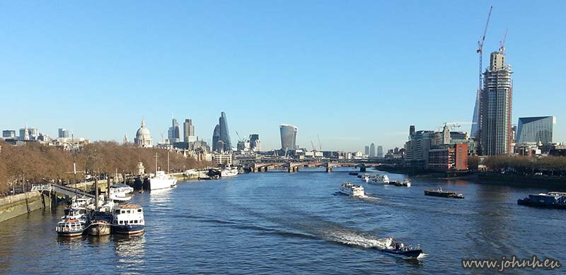 View from Waterloo Bridge of the City of London and the towers of Canary Wharf
