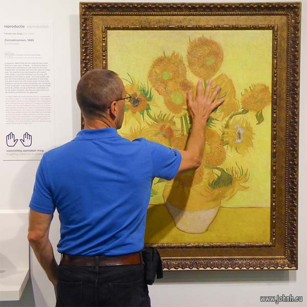 Touching van Gogh's sunflowers at the Van Gogh museum, Amsterdam