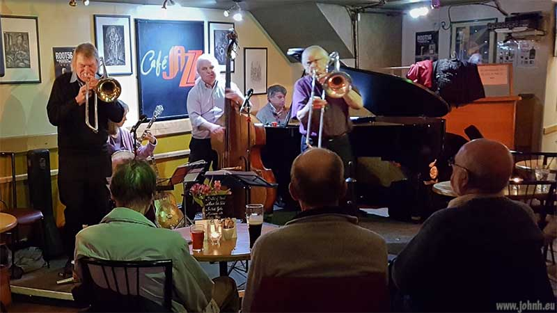 Two trombonists and band playing at Cafe Jazz, Cardiff