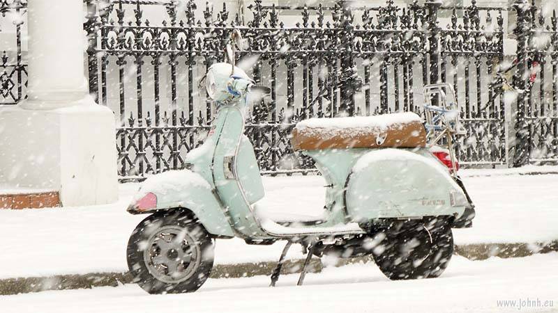 Vespa PX125 scooter in the snow