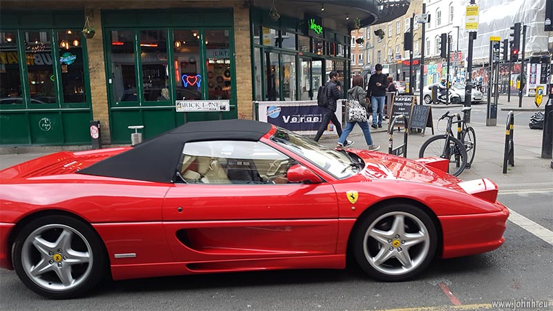 Ferrari car exiting Brick Lane, London E1