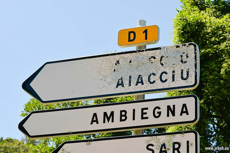 bullet-holed road signs, Corsica