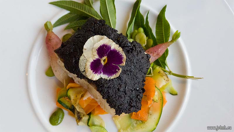 Cod with black olive tapenade and flowers, Corsica