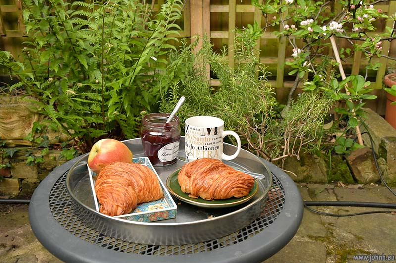 Fresh artisan croissants and coffee for breakfast in my garden in London W14
