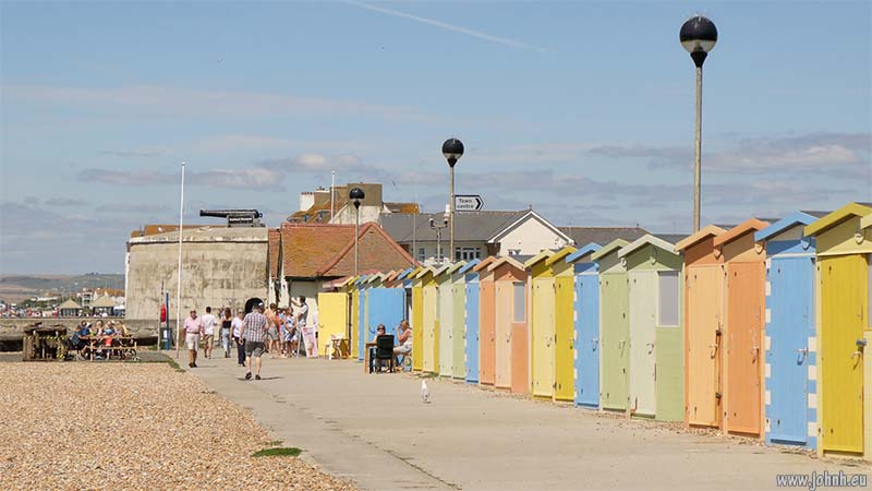 Seaford beach huts and Martello Tower, East Sussex